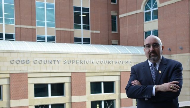 Attorney Moore in front of the Cobb County Superior Courthouse